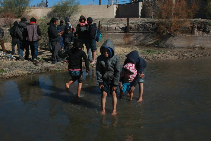 Children cross the Rio Bravo to the US in Chihuahua, Mexico, on Dec. 19.