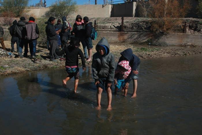 Children cross the Rio Bravo to the US in Chihuahua, Mexico, on Dec. 19.
