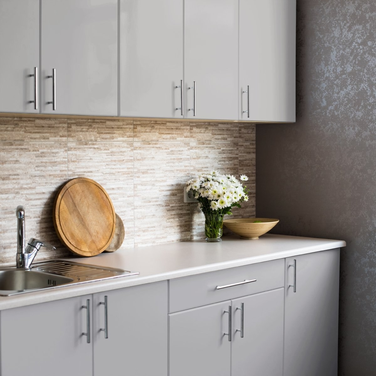 kitchen with light gray modern looking kitchen cabinets