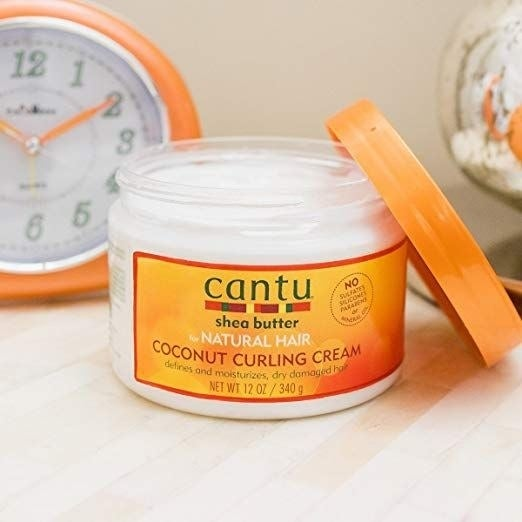"""Promising review: """"This is by far the best curling cream I have ever used on my naturally curly hair. You don't require much and it accents your natural curl pattern perfectly. It's not too heavy, and not too light; I think it's just right."""" —SherylPrice: $29.03 (for a pack of four jars)"""