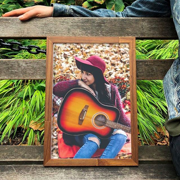 framed photo of model with a guitar