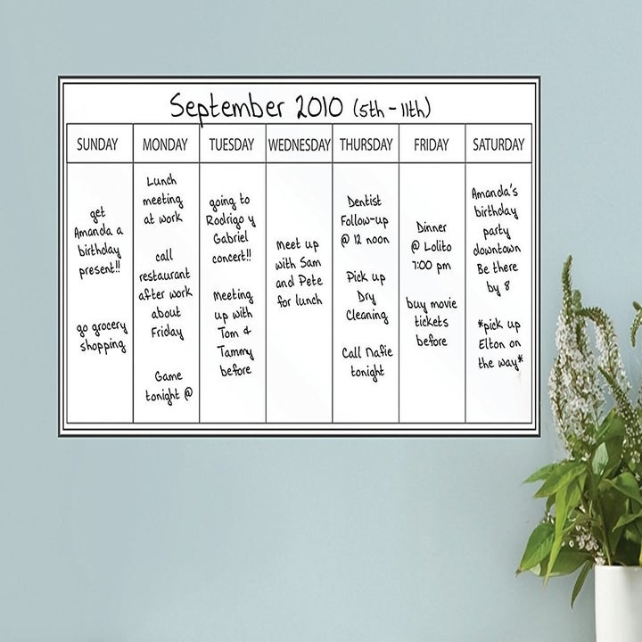 The white weekly calendar stuck to a wall