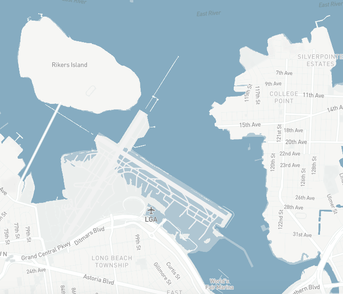 """LaGuardia Airport is mostly is in the """"risk zone"""" (light blue) in 2050, assuming moderate emissions cuts."""
