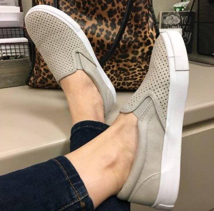 c81e8339ab2 Perforated slip-on shoes available in a bunch of neutral colors you ll want  to ~slip on~ to your piggies immediately.