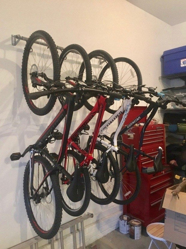 """Promising review: """"This works great for our bikes. It's pretty easy to get the bikes up and down. I was so tired of having the bikes cluttering the garage. This works great to get the bikes up off the floor and keep them organized. This works great for multiple bikes and it doesn't keep them so close together that you can't easily get one of the middle ones down. I definitely recommend it!"""" —JennaGet it from Amazon for $64+ (available in various sizes)."""