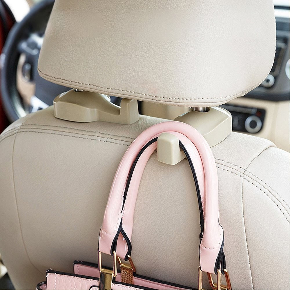 "Promising review: ""I purchased these so my purse would not tumble off the car seat and so I can hang plastic bags that hold my groceries. I have one facing forward and one facing backwards. I hang my purse on the forward facing one and hang bags on the rear-facing one. They worked great."" —MattiePrice: $7.95 (for a pair; available in beige and black)"