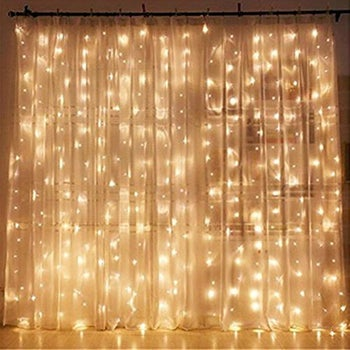 curtain of string lights layered with sheer curtain