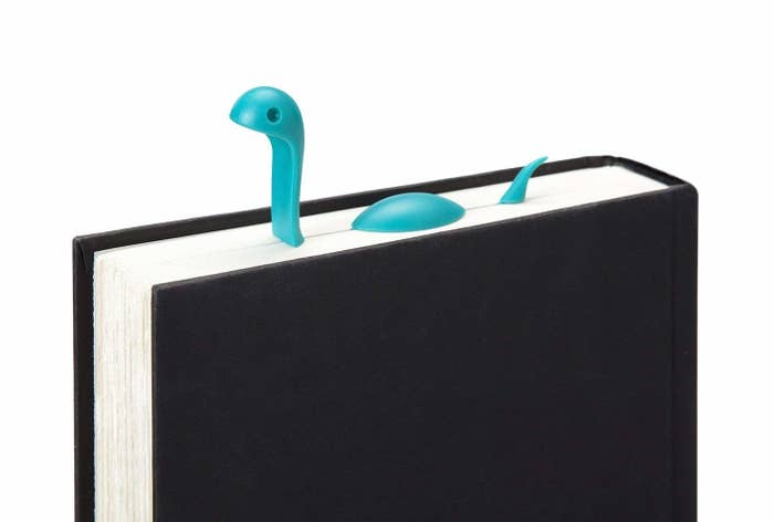 bookmark that looks like loch ness monster swimming in between pages