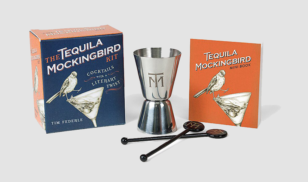 Product shot of the packaging, shot glass, stirrers, and tequila mockingbird book