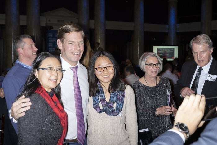 Rep. Eric Swalwell with Marrina Lan and Feng Xue of Ames, Iowa, at the Progress Iowa Holiday Party in Des Moines on Dec. 20.