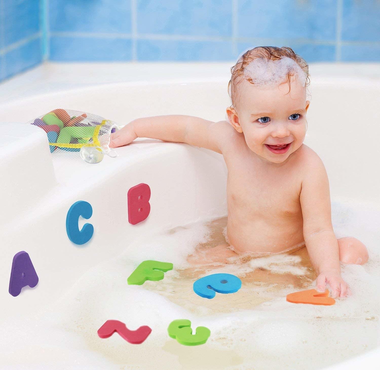 child in bath using foam letters