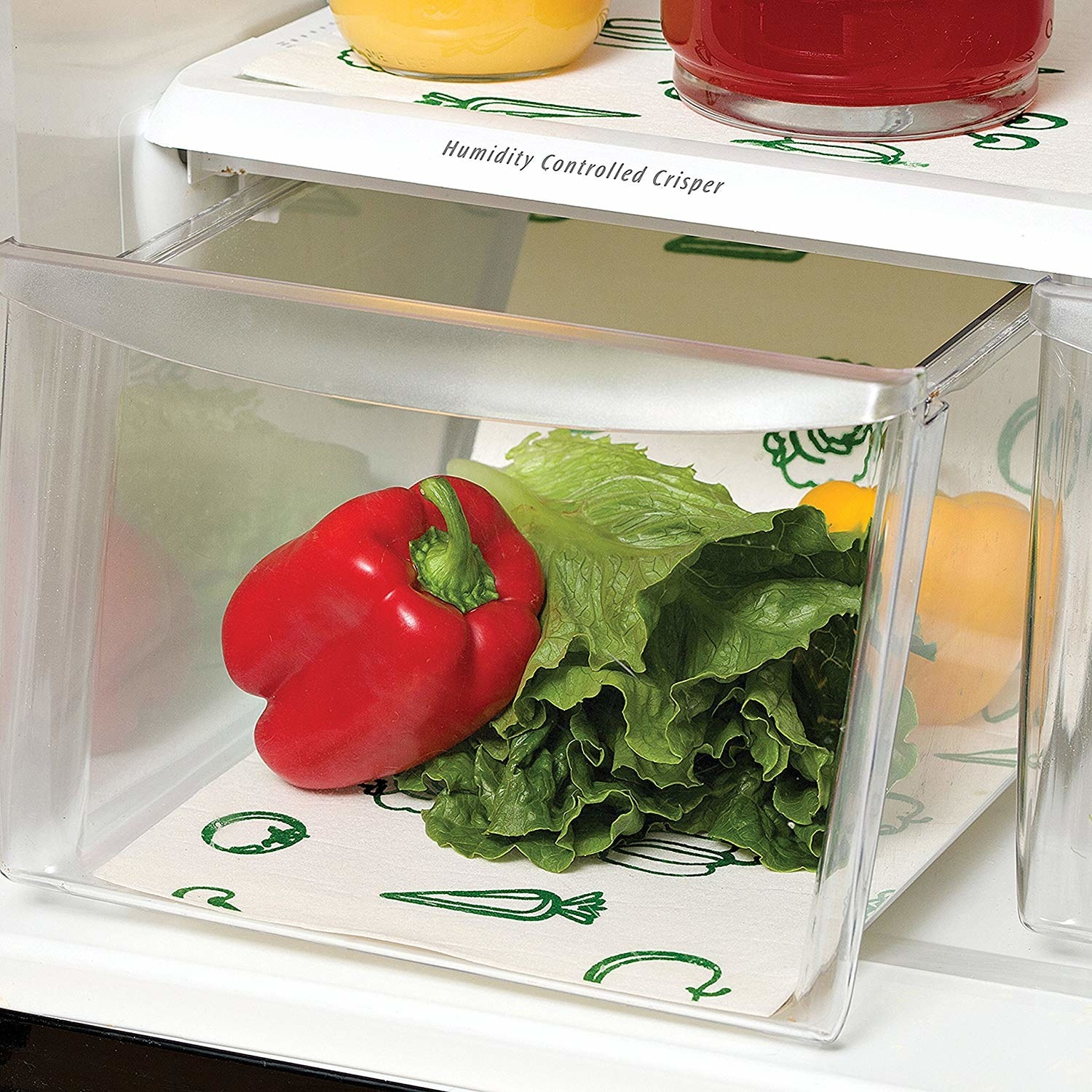 The shelf liners being used with to keep peppers and lettuce fresh in the fridge