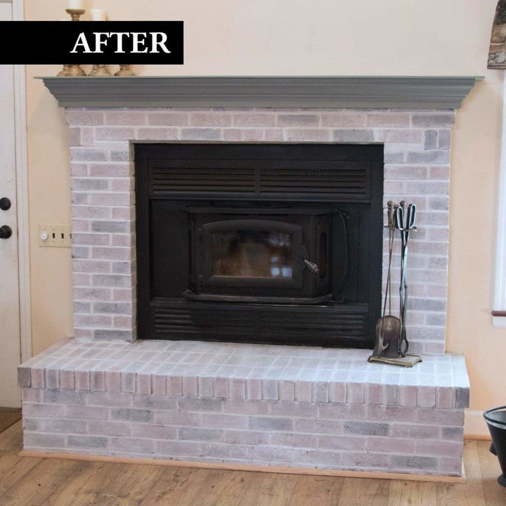 after pic of brick fireplace with whitewash finish for a gray look