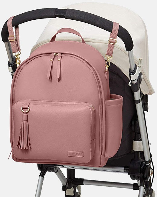 """The bag features nine pockets, including a large main compartment and changing-pad pocket that can also hold a tablet or laptop up to 15"""".Promising review:""""I am so glad I bought this bag. I was looking for a backpack diaper bag that was stylish and didn't give off the obvious baby bag vibe. It's a great size and perfect for everything you would ever need for your baby. The stroller straps are so convenient, too. I get compliments every time I used it. So happy with this purchase!"""" —Matthew GreenGet it from Amazon for$79.99+(available in five colors)."""