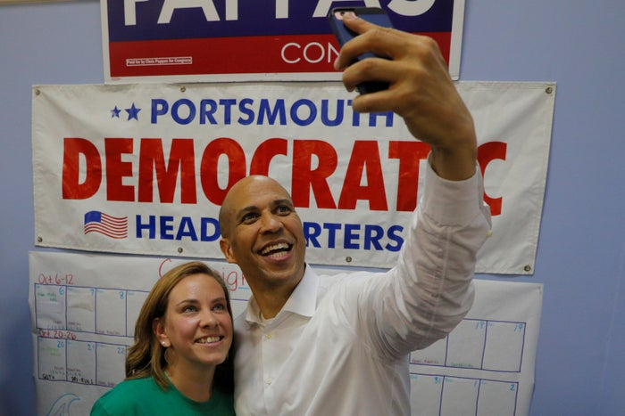 Booker takes a selfie with a campaign canvasser ahead of the midterms in Portsmouth, New Hampshire, on Oct. 28.