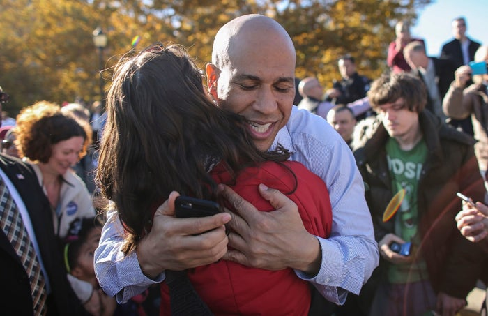 Cory Booker hugs a supporter at a pre-election rally on Nov. 4 in Hoboken, New Jersey.