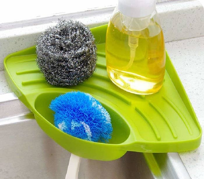 """Promising review: """"This is the only caddy I've found that keeps your sponge from sitting in a pool of water. It drips right into the sink, it's SUPER easy to clean (you can just throw it in the dishwasher if you're feeling lazy), and it fits perfectly. I've had mine for quite a while now and I love it."""" —Amanda IvansGet it from Amazon for $8.69."""