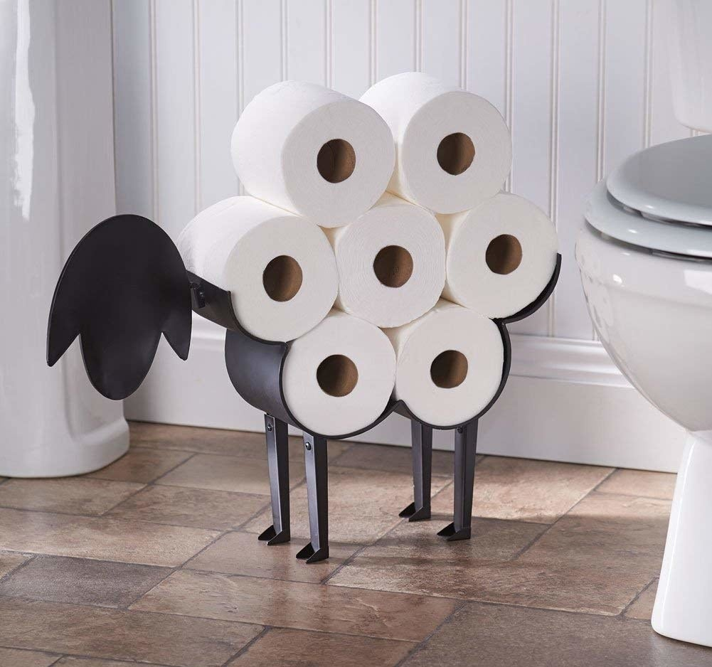 metal sheep holder with seven rolls of toilet paper that look like its wool