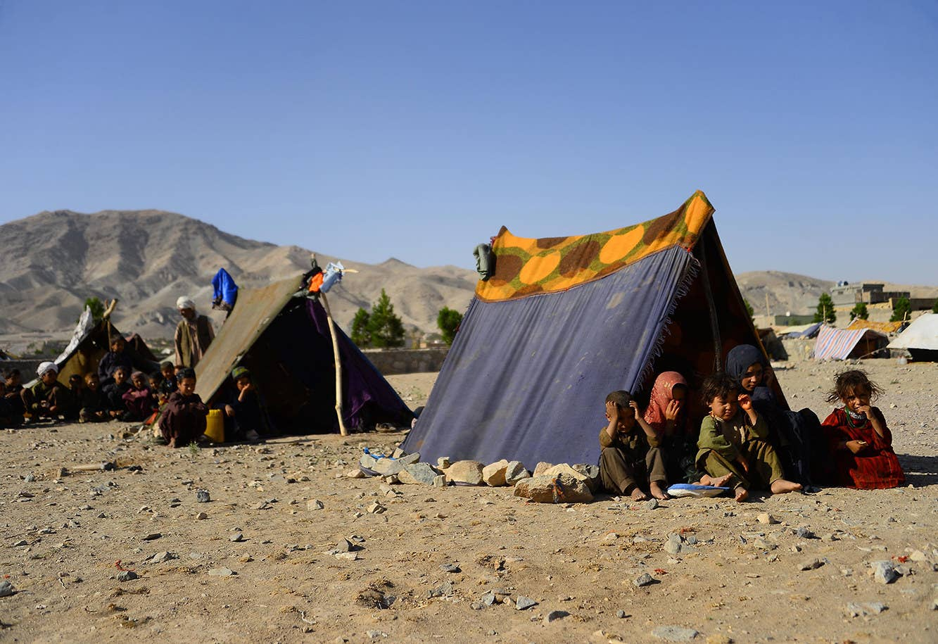Drought-displaced Afghan children at their tent at a camp for internally displaced people in the Injil district of Herat province in Afghanistan on Aug. 3.
