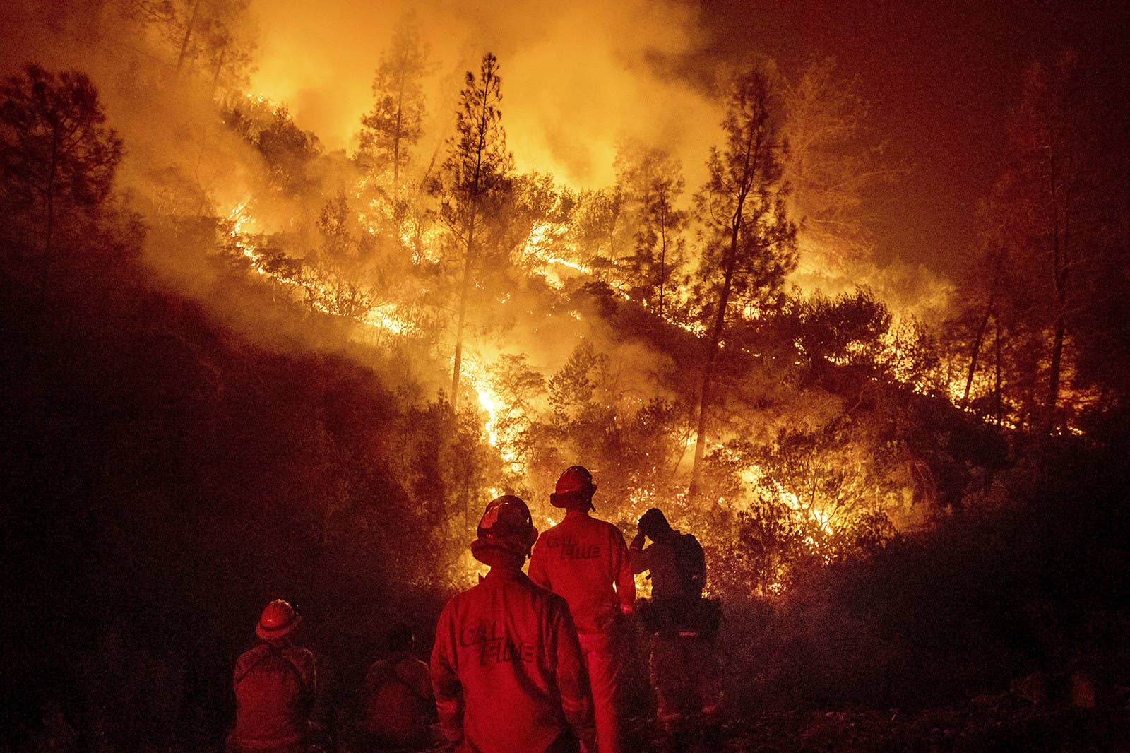 Firefighters monitor a backfire while battling the Ranch fire in Northern California, Aug. 7.
