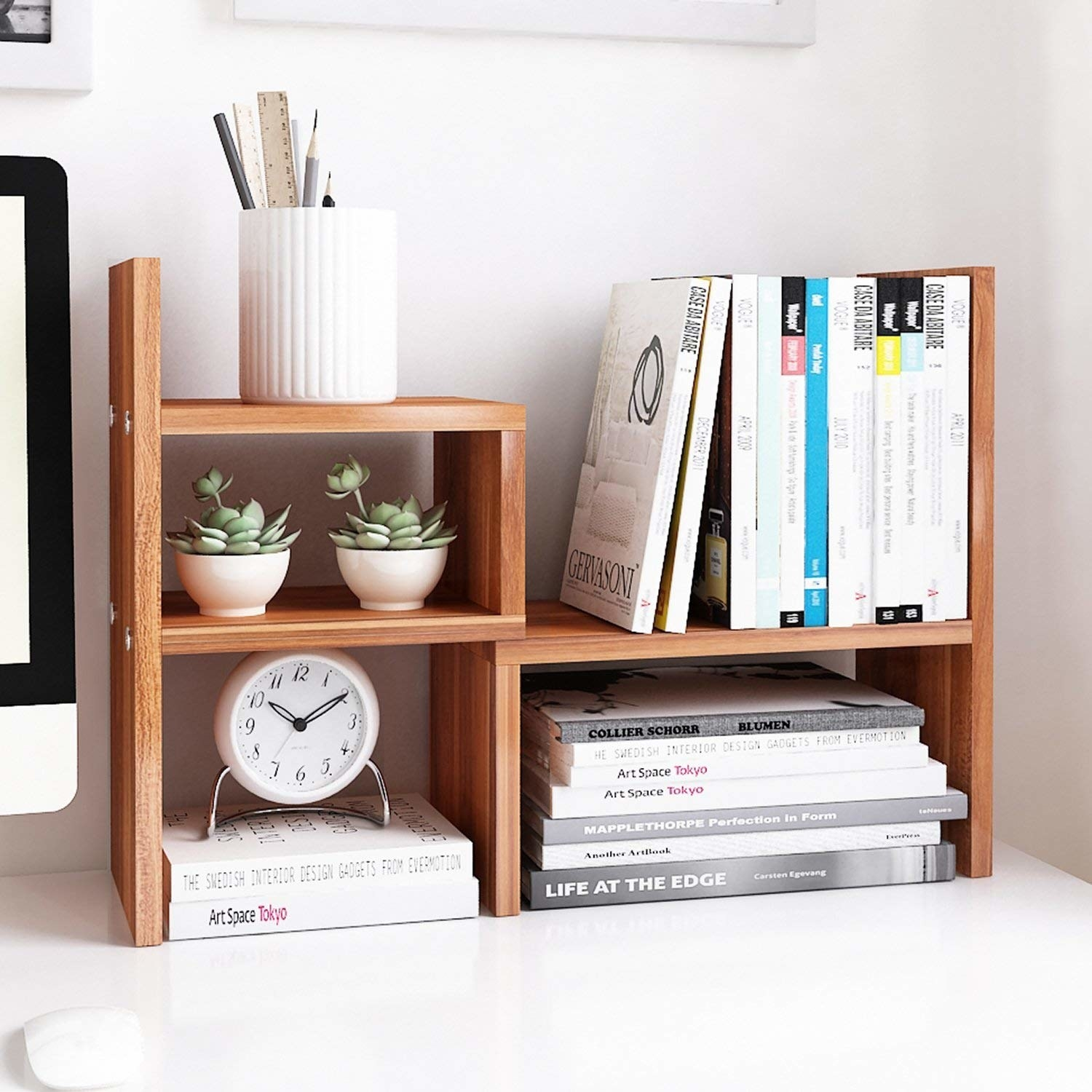 books and plants organized in the wooden desktop organizer