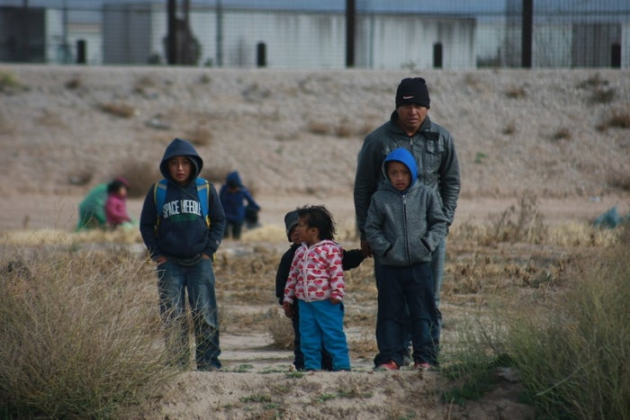 A group of about 150 migrants attempt to cross the Rio Bravo to reach the United States in Ciudad Juarez, Chihuahua state, Mexico, on Dec. 18, 2018.
