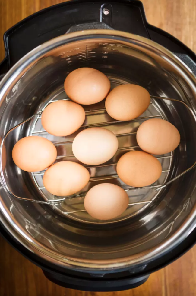 Before you cook anything in an Instant Pot, you have to do a water test, aka boil water to make sure it works properly. The good news is that you can pop some eggs in that water, and when the test is done, you'll have some fresh HBEs, the first food you've made with your new gadget.