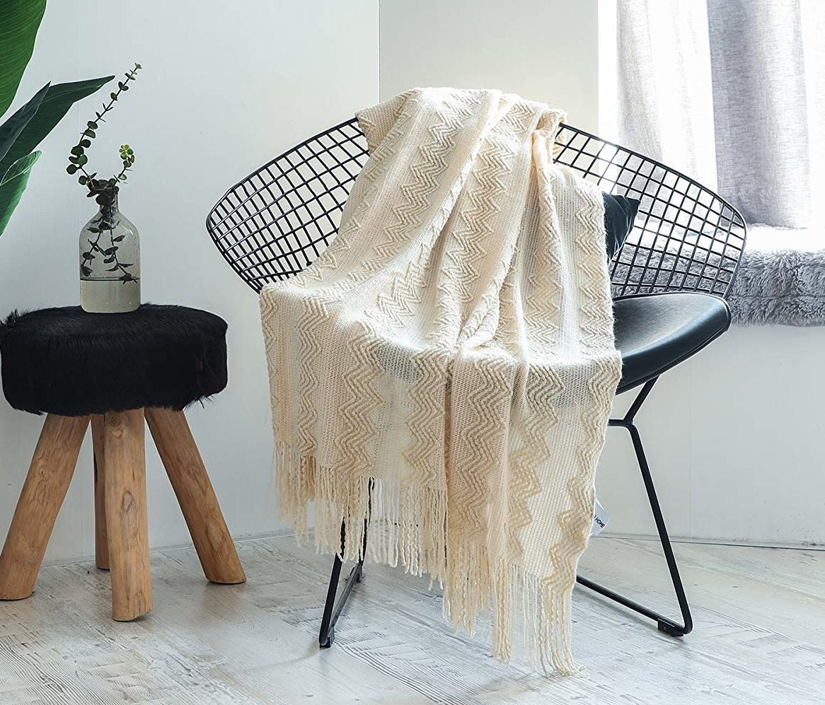 a desk chair with the desk blanket draped over it