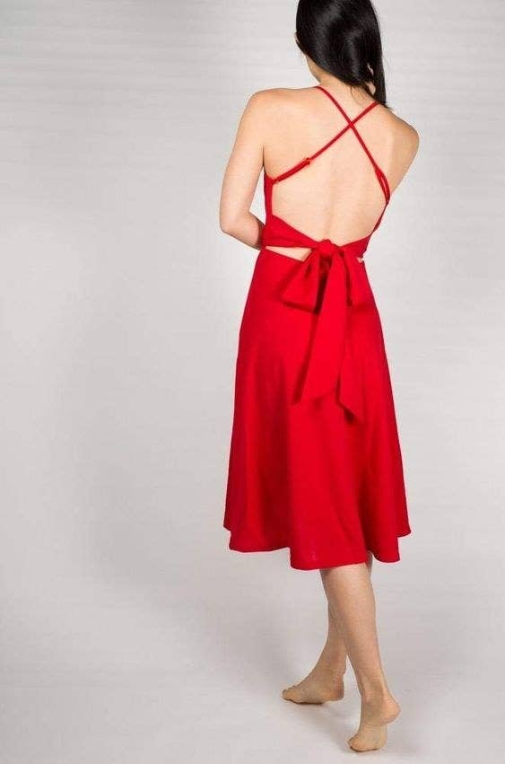 4655fe4d A spaghetti strap party dress with a bow in the back for a custom fit,  because you look too cute to worry about a wardrobe malfunction.
