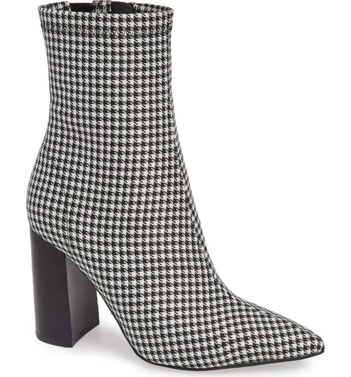 f2be2eff4f3 A pair of houndstooth-print booties to bring a touch of sophistication to  your favorite outfits.