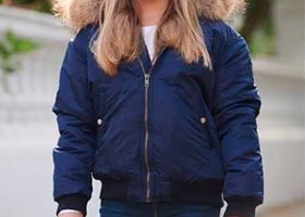 A bomber jacket with a fur trim hood