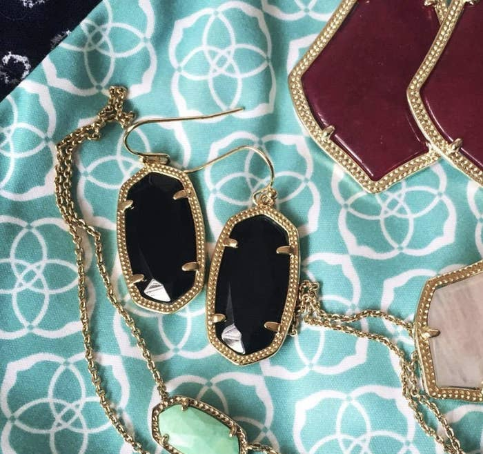 cf0120199c A pair of classic Kendra Scott drop earrings that feature a simple design  but are so gorgeous you'll start planning your outfits around them.
