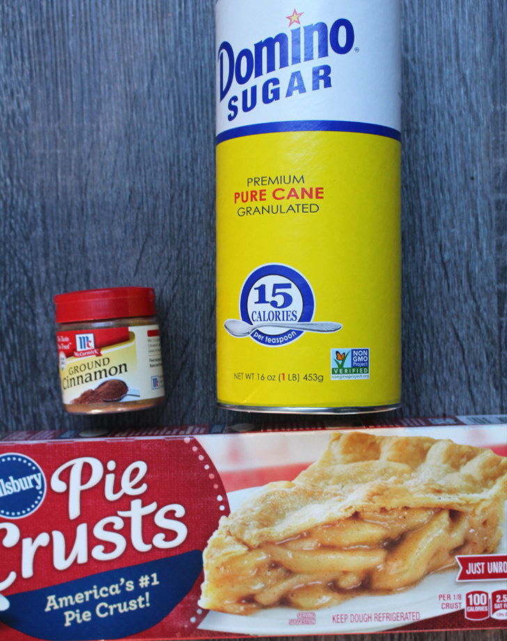Since I'm a lazy baker, store-bought pie crusts are a good friend of mine (especially around Thanksgiving time). But I've never used them to make cookies before. What you'll need: Store-bought pie crust, cinnamon, and granulated sugar.