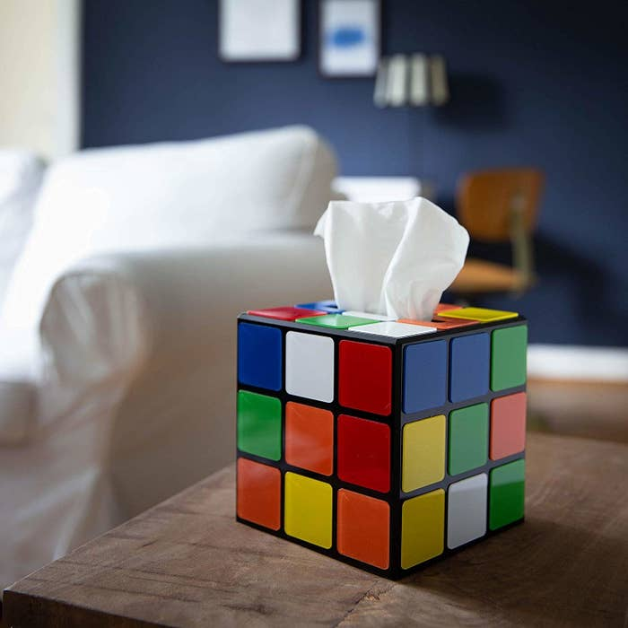 Puzzle cube tissue box on table