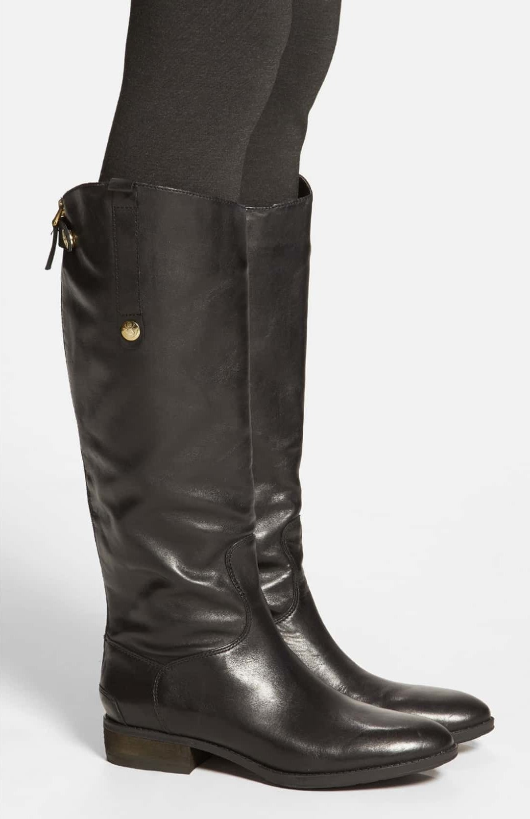 The knee-high boots with a slight heel and rounded toe in black