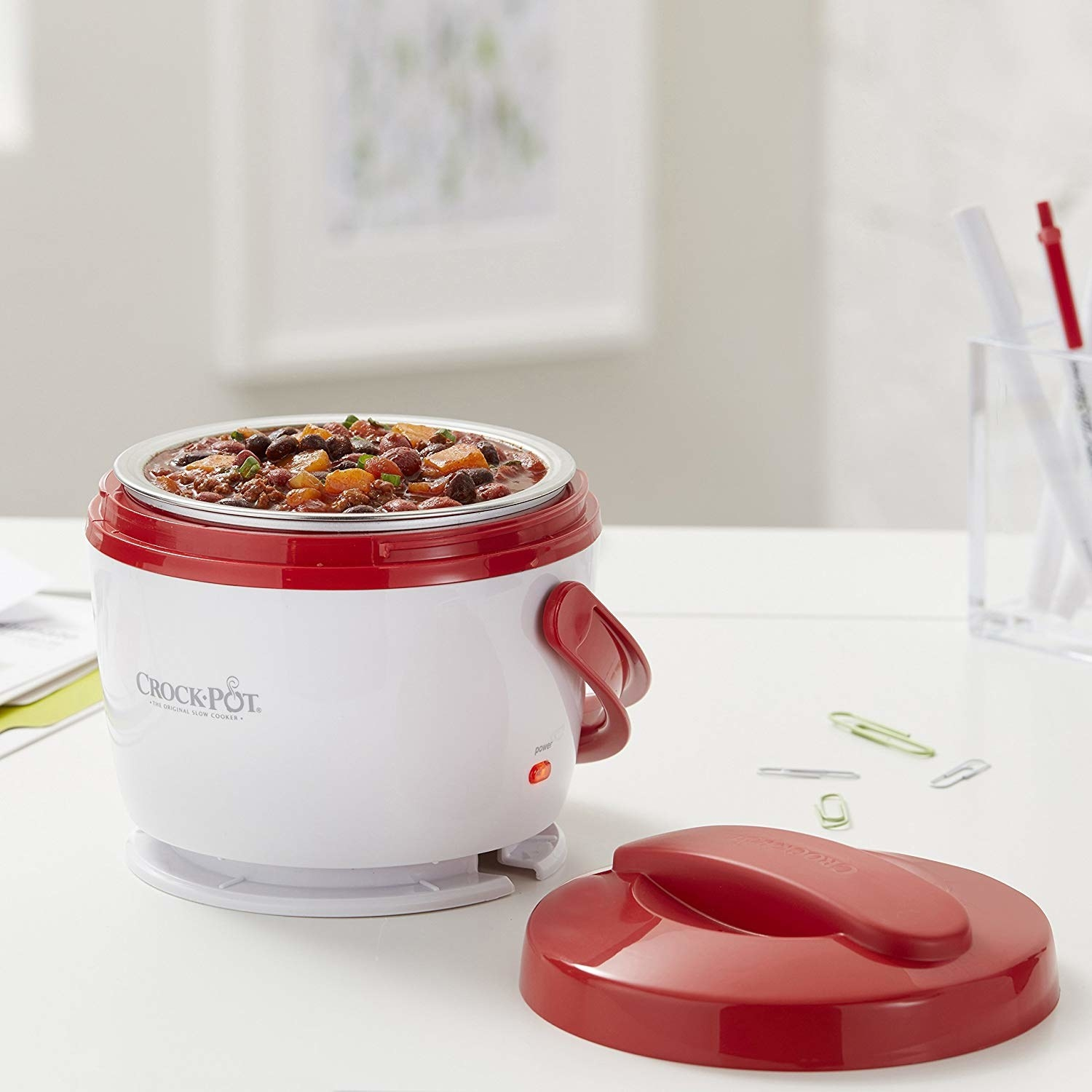 "It has a 20-ounce capacity, a dishwasher-safe removable container, and a spill-proof lid.Promising review: ""Love this food warmer. I use it for lunch and dinner at work every day. I meal prep by freezing big batches of food in small freezer bags and place them inside of coffee mugs so the food is in a shape that will fit in the Crock-Pot. I let the food cook from frozen for about two hours, and it comes out perfectly."" —Karen w.Get it from Amazon for $21.99+ (available in four colors)."