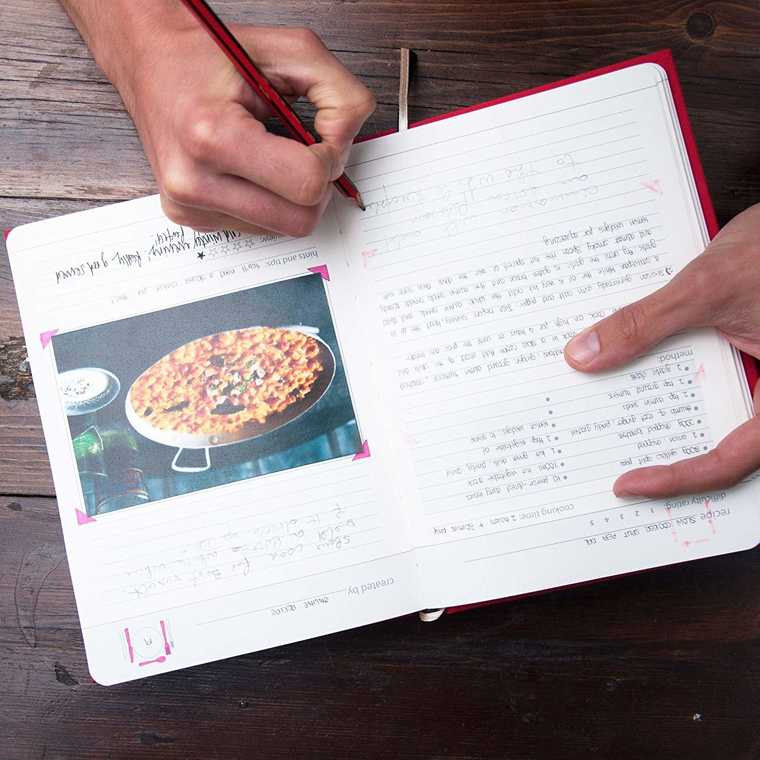 inside of the recipe book with a picture of food taped to the page