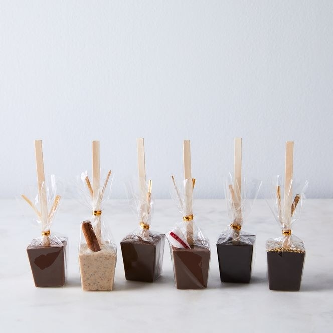 cubes of chocolate with wooden sticks in them