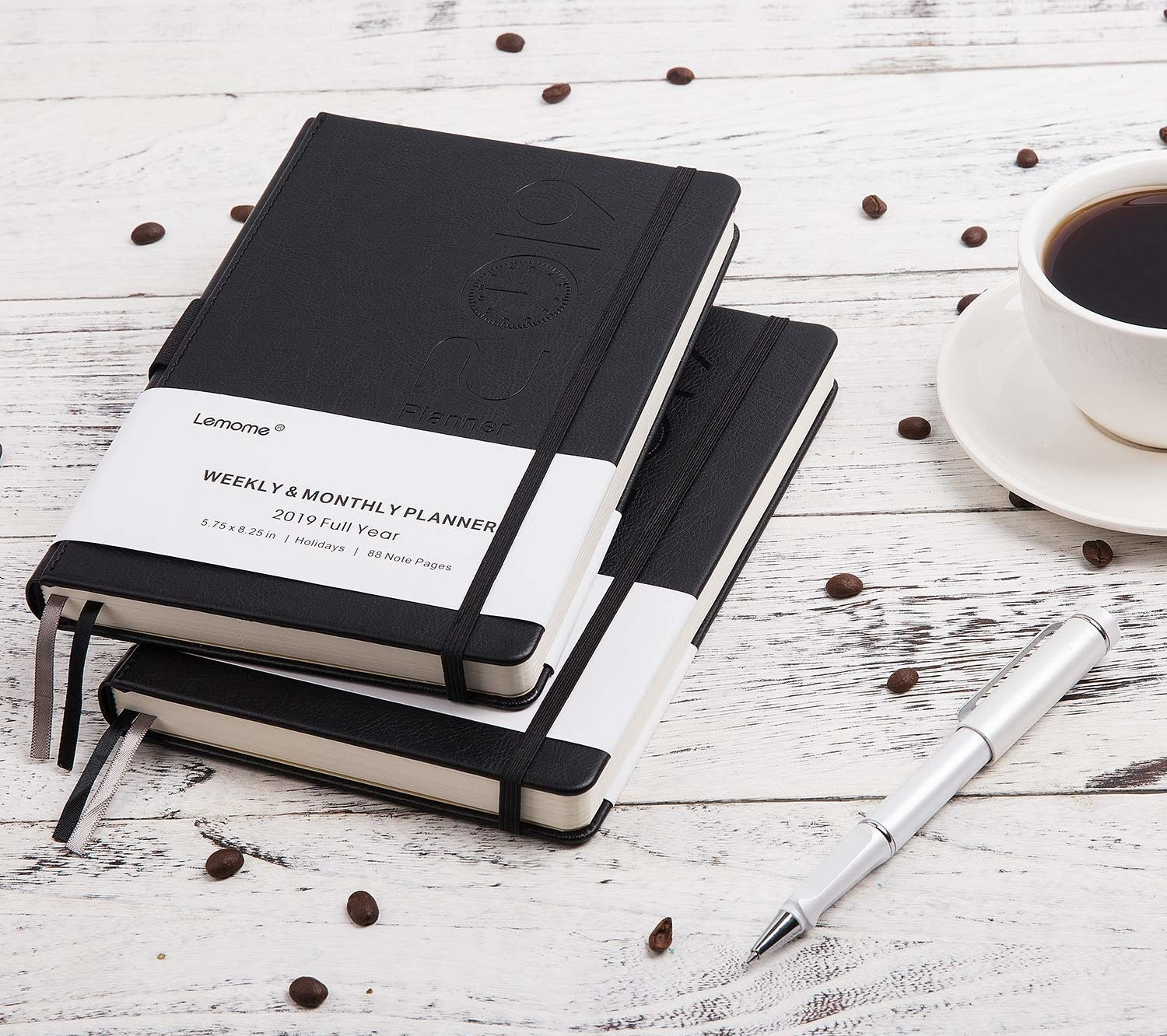 Monthly planner on white wooden table