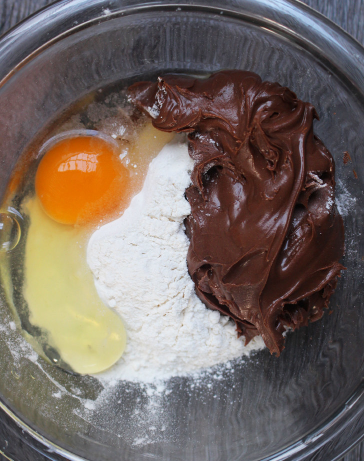 The process:  Just mix the three ingredients together in a bowl, scoop the chocolate dough into little balls on parchment paper, and bake them for eight minutes. Allow them cool for a few minutes once out of the oven.