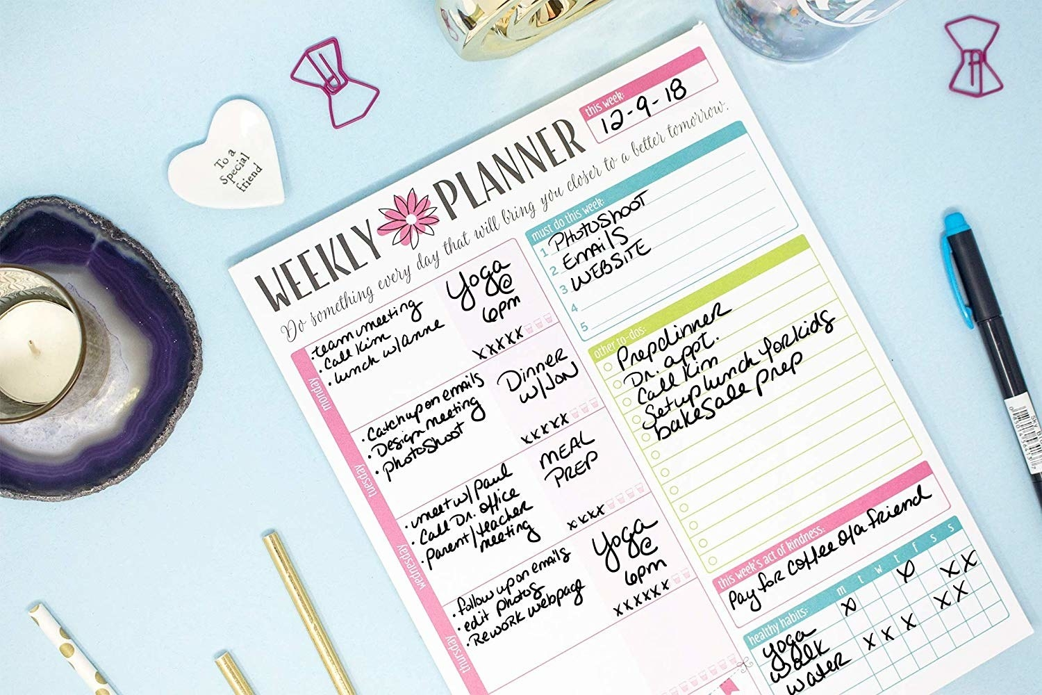 "Promising review: ""This is a great planner! It is a nice thick stack of weekly planners that tear off really easily. I am getting so much more done now. I used to write my to-do lists on an index card, but I was always losing them. This is great because the whole week is there — and it is nice and colorful so I can't miss it on my desk or in my pocketbook. Makes me more productive."" —bougaGet it from Amazon for $11.95. Or, check out a daily planning pad."