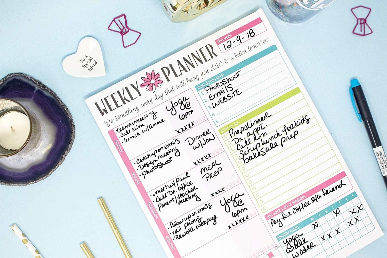 Weekly planner on blue desk