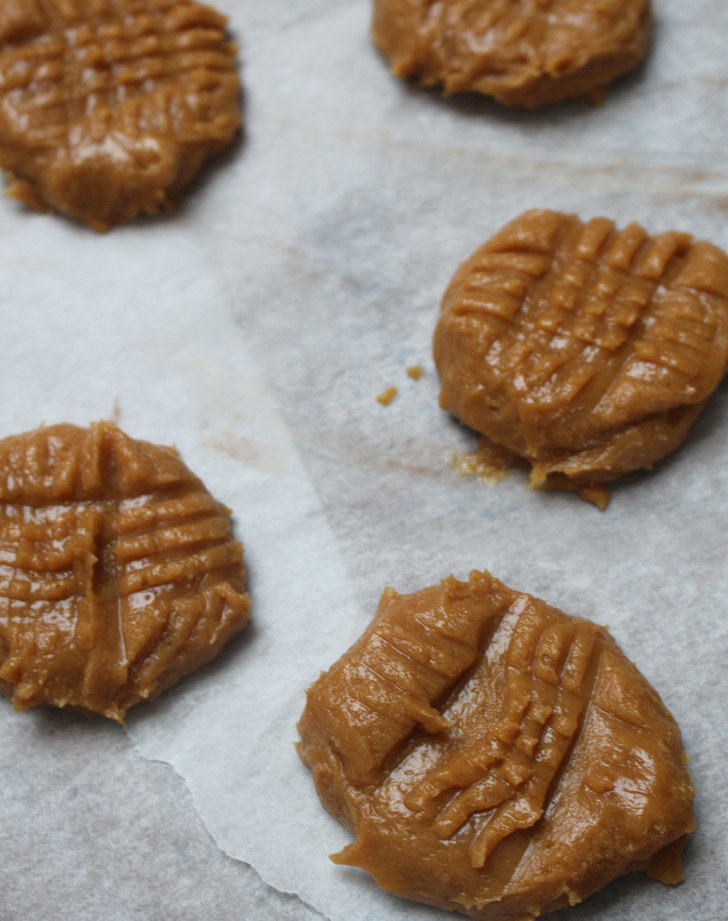 The process:  These cookies are basically foolproof: Just mix all the ingredients together and combine until smooth. Then, make little balls of the peanut butter dough, place them in parchment paper, and flatten the dough out with the back of a fork.