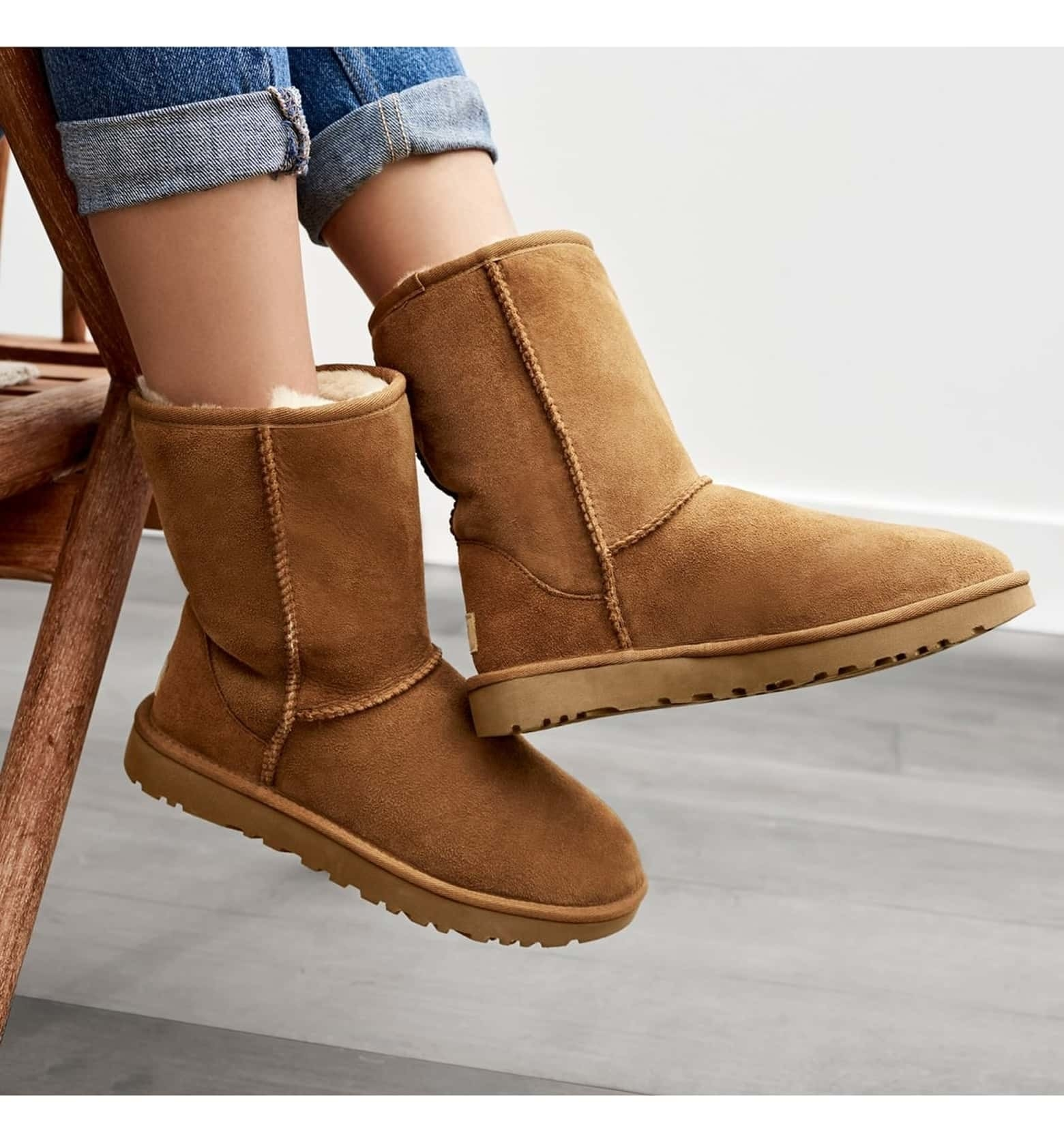 The suede boots in brown that come up to mid calf-height
