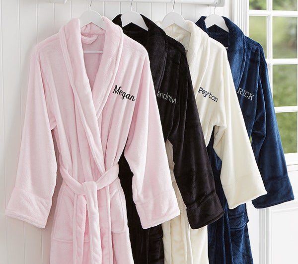 Various colors of the robe with names embroidered on them