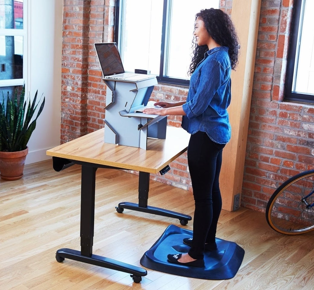 "Promising review: ""I purchased this cardboard standing desk while waiting for my back-ordered VariDesk to arrive at the office. Oh my!! The traffic at my desk to view my 'temporary' stand-up desk has been overwhelming. The design, sturdiness, and functionality have made this cardboard desk the talk of the office. Some genius design engineer had a light bulb moment. I could use this for years... if only it was height-adjustable from standing to sitting height. Priceless!"" —EyeLoveGlassesGet it from Amazon for $25 (available in three sizes)."