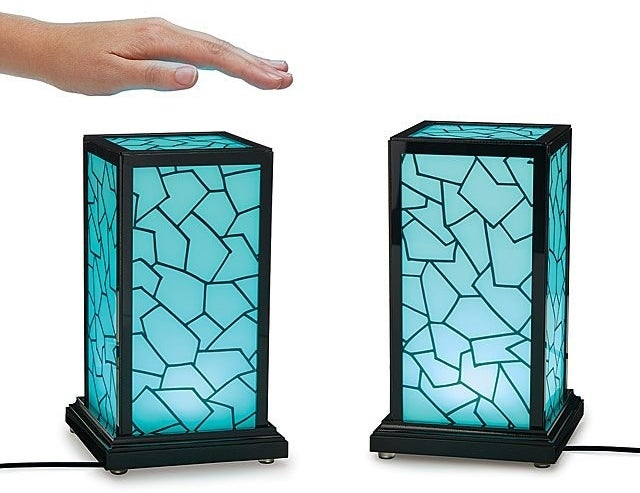 The two touch lamps lit up in blue