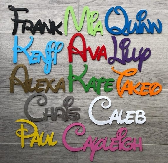 Various colored Disney font wooden name signs