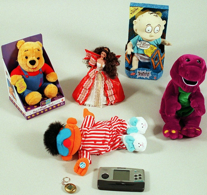 These toys, photographed in New York City on Nov. 17, 1997, are among those expected to be popular during the holiday season. Top row, from left: Winnie the Pooh plush toy, Holiday Barbie, and a Tommy Pickles doll from Rugrats. Center row, from left: Sing and Snore Ernie and Microsoft's ActiMates Barney. Bottom row, from left: a Tamagotchi virtual pet and Tiger Electronics' Game.com.