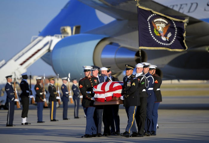 The casket containing the late George H.W. Bush arrives in Washington at Joint Base Andrews in Morningside, Maryland, on Monday.